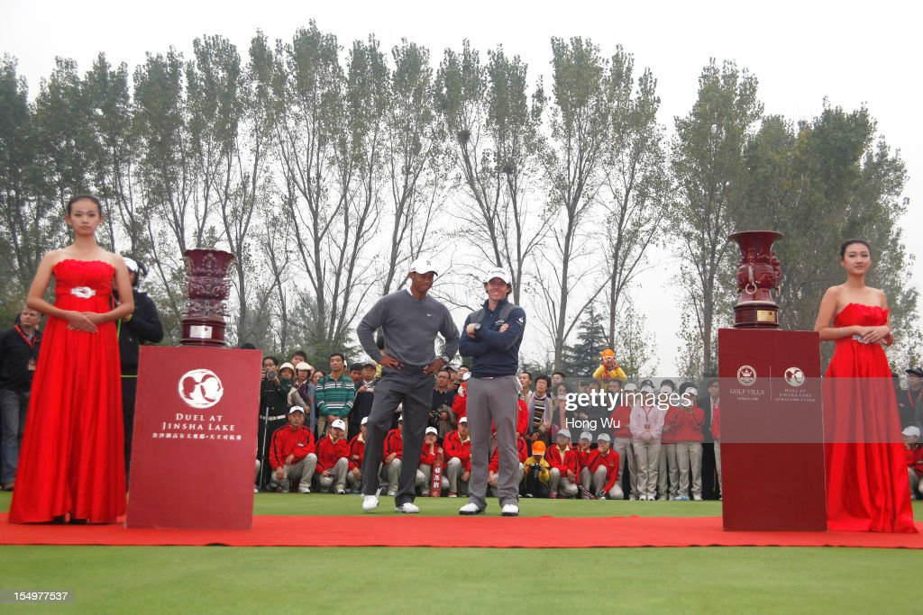 Tiger Woods of USA and Rory McIlroy of Northern Ireland attend the award ceremony during the Duel of Tiger Woods and Rory McIlroy at Jinsha Lake Golf Club on October 29, 2012 in Zhengzhou, China.