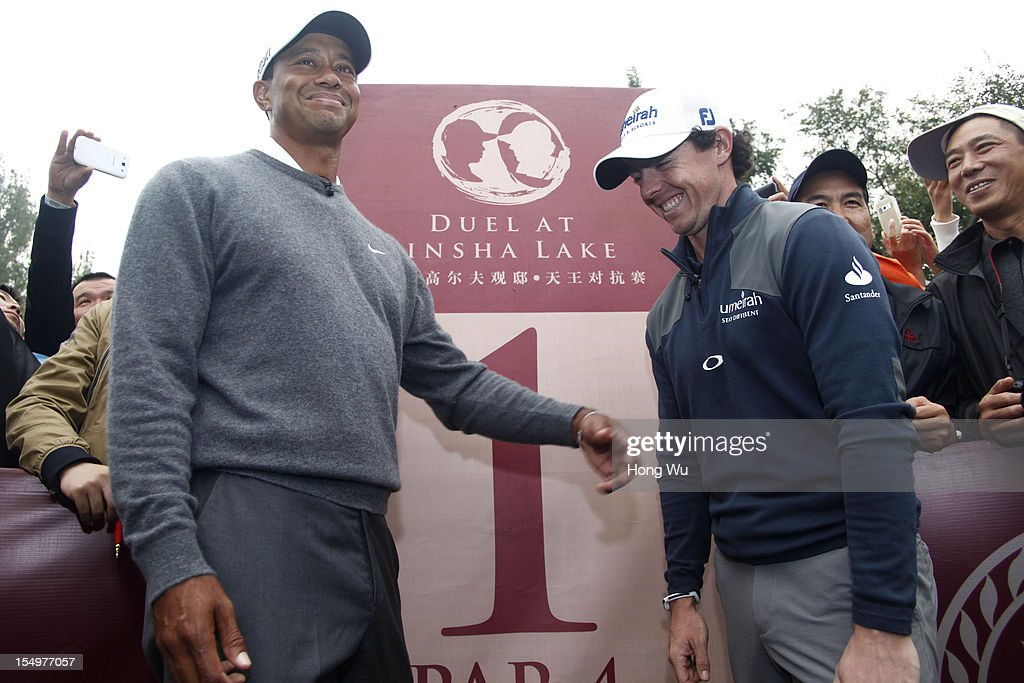 Tiger Woods of USA (L) and Rory McIlroy of Northern Ireland smile as they take photos before kick off during the Duel of Tiger Woods and Rory McIlroy at Jinsha Lake Golf Club on October 29, 2012 in Zhengzhou, China.