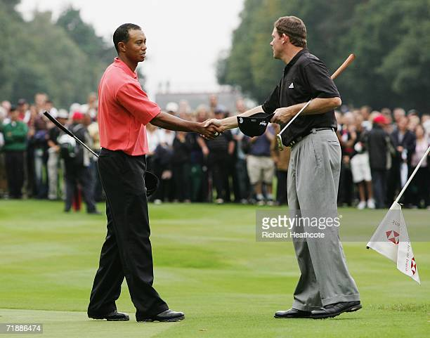 Tiger Woods of USA congratulates Shaun Micheel of USA on his victory on the 15th green during the First Round of the HSBC World Matchplay...