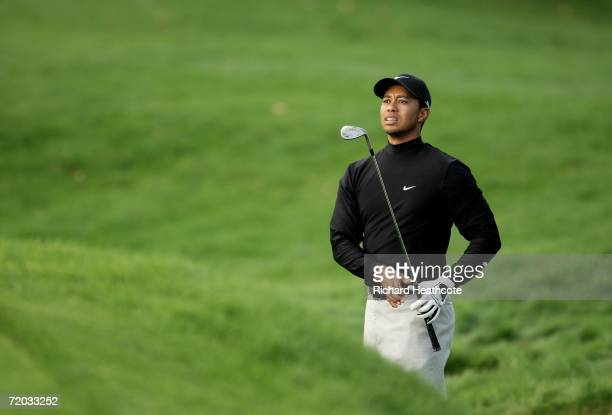 Tiger Woods of USA follows his approach shot on the 15th hole during the first round of the WGC American Express Championship at The Grove on...