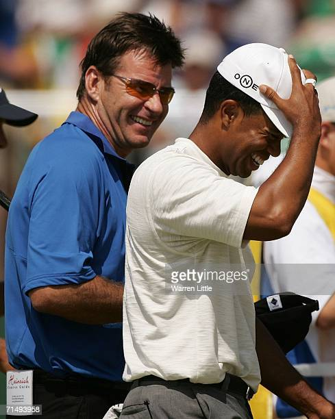 Tiger Woods of USA has a laugh with Nick Faldo of England on the 18th green during the second round of The Open Championship at Royal Liverpool Golf...