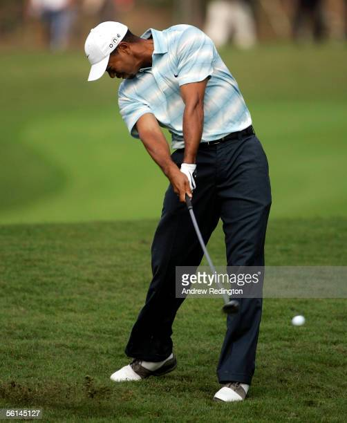 Tiger Woods of USA hits his second shot on the second hole during the third round of the HSBC Champions tournament on November 12 2005 at The Sheshan...
