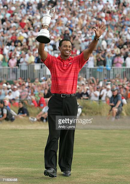 Tiger Woods of USA holds the claret jug aloft following his two shot victory at the end of the final round of The Open Championship at Royal...