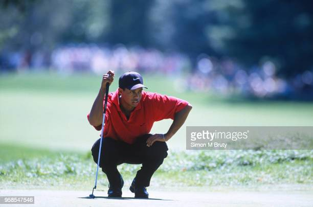 Tiger Woods of USA lines up a putt during the final round of the U.S.P.G.A. At Winged Foot Golf Club on August 17, 1997 in Mamaroneck, New York.