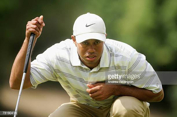 Tiger Woods of USA lines up his putt on the third hole hole during the third round of the Dubai Desert Classic on the Majilis Course at Emirates Golf...