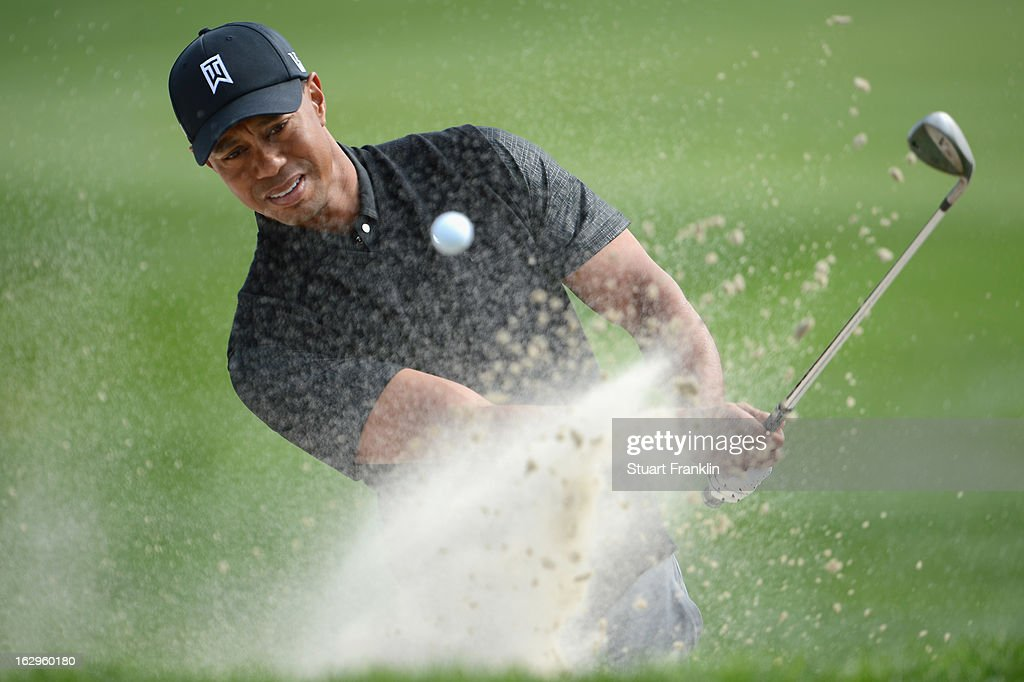 Tiger Woods of USA plays a bunker shot on the 11th hole during the third round of the Honda Classic on March 2, 2013 in Palm Beach Gardens, Florida.