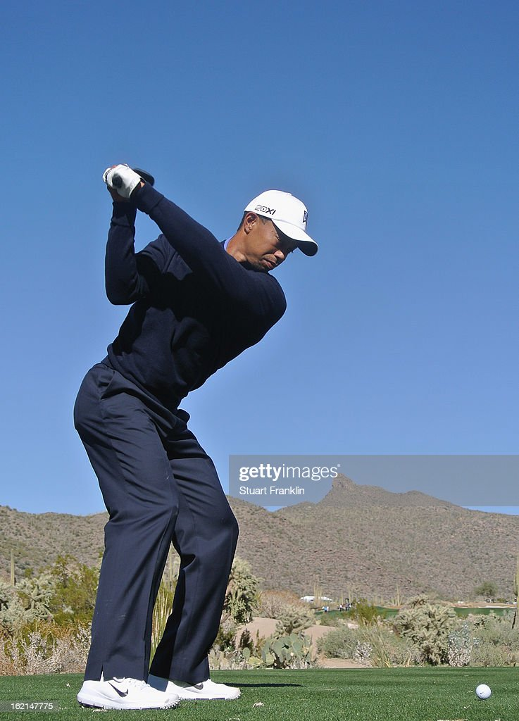 Tiger Woods of USA plays a shot during practice prior to the start of the World Golf Championships-Accenture Match Play Championship at the Ritz-Carlton Golf Club on February 19, 2013 in Marana, Arizona.