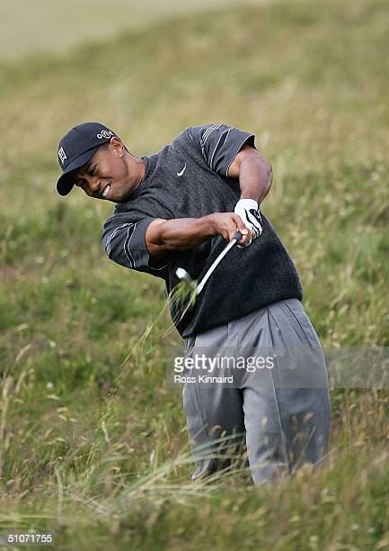 Tiger Woods of USA plays out of the rough on the 4th hole during the first round of the 133rd Open Championship at the Royal Troon Golf Club on July...