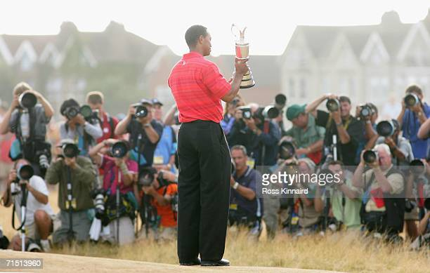 Tiger Woods of USA poses with the claret jug in front of the media following his two shot victory at the end of the final round of The Open...