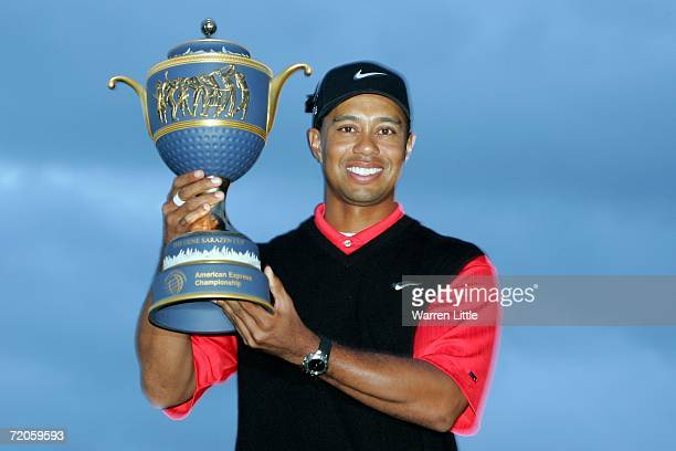 Tiger Woods of USA poses with The Gene Sarazen Cup following his victory in the final round of the WGC American Express Championship at The Grove on...