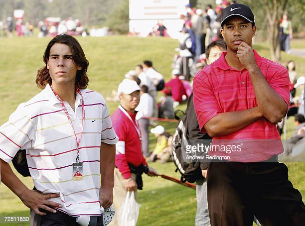 Tiger Woods of USA stands with Rafael Nadal Spanish tennis star on the 14th hole during the final round of The HSBC Champions tournament at The...