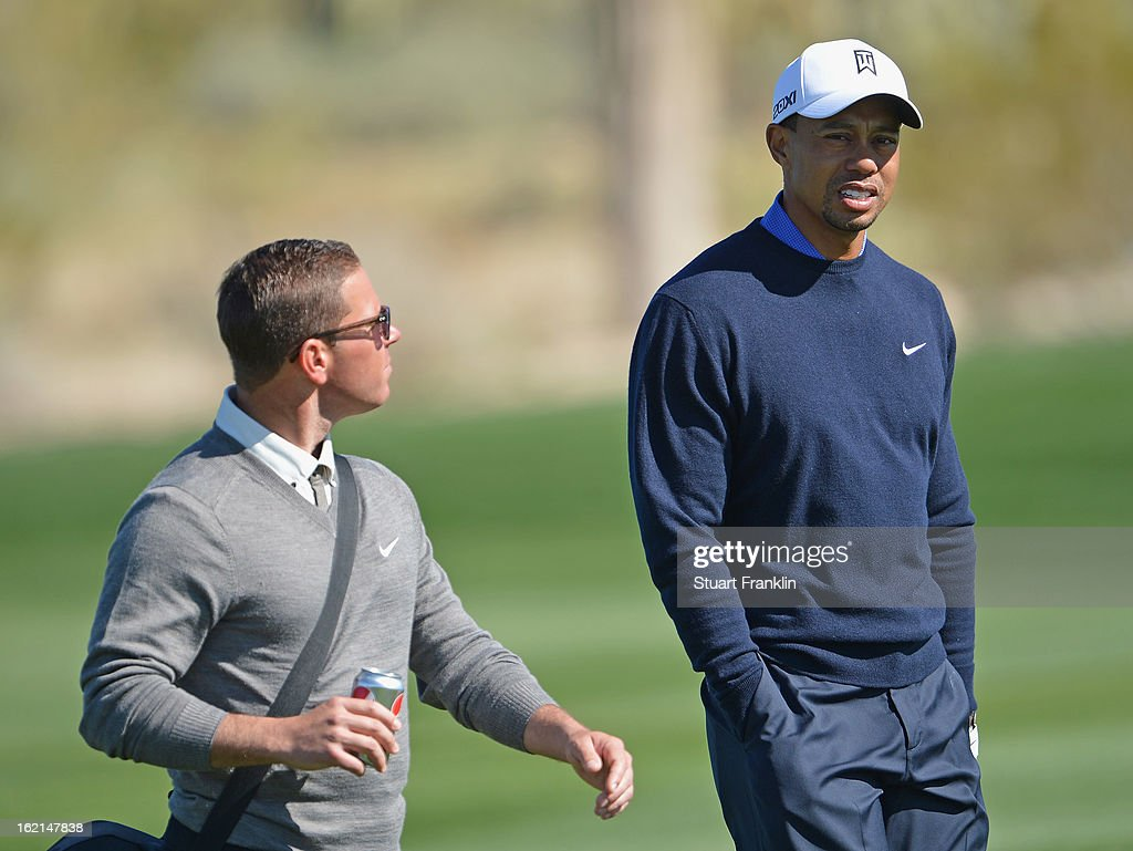 Tiger Woods of USA talks with coach Sean Foley during practice prior to the start of the World Golf Championships-Accenture Match Play Championship at the Ritz-Carlton Golf Club on February 19, 2013 in Marana, Arizona.