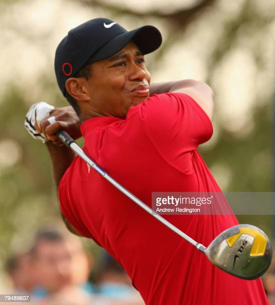 Tiger Woods of USA tees off on the 18th hole during the final round of the Dubai Desert Classic on the Majilis Course at the Emirates Golf Club on...
