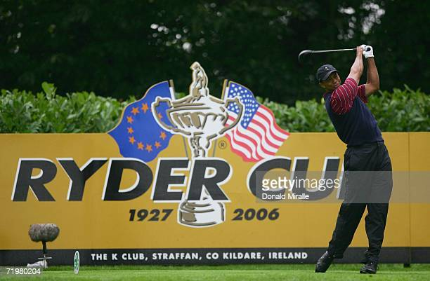 Tiger Woods of USA tees off on the 4th hole during his singles match against Robert Karlsson of Europe on the final day of the 2006 Ryder Cup at The...