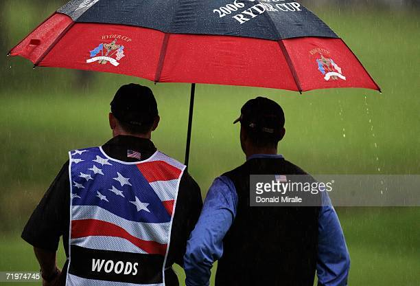 Tiger Woods of USA waits to putt with caddy Steve Williams during the morning fourballs on the second day of the 2006 Ryder Cup at The K Club on...