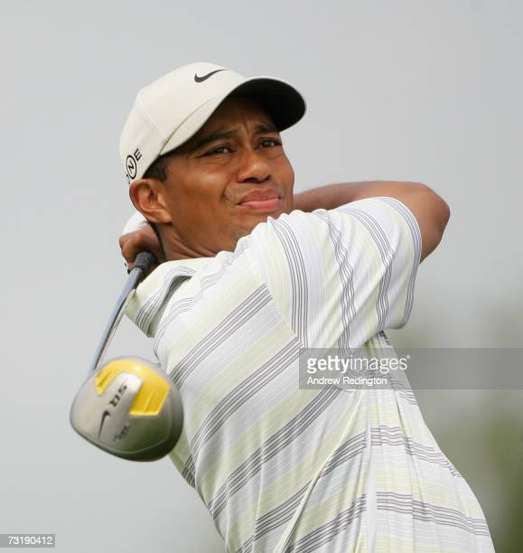 Tiger Woods of USA watches his teeshot on the third hole during the third round of the Dubai Desert Classic on the Majilis Course at Emirates Golf...