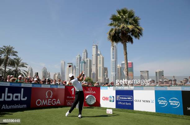 Tiger Woods off United States tees off on the first hole during the Champions Challenge as a preview for the 2014 Omega Dubai Desert Classic on...