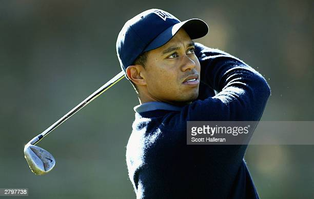 Tiger Woods on the practice range during the pro-am at the Target World Challenge December 9, 2003 at Sherwood Country Club in Thousand Oaks,...