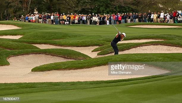 Tiger Woods out of the fairway bunker on the 13th hole during the second round of the Honda Classic at PGA National Resort and Spa on March 1 2013 in...