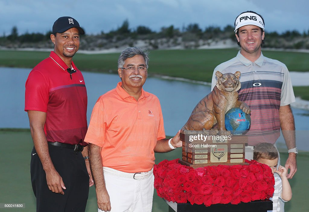 Tiger Woods, Pawan Munja of Hero Motocycles and Bubba Watson pose with the trophy after Watson's three-stroke victory at the Hero World Challenge at Albany, The Bahamas on December 6, 2015 in Nassau, Bahamas