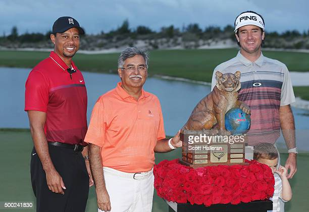 Tiger Woods Pawan Munja of Hero Motocycles and Bubba Watson pose with the trophy after Watson's threestroke victory at the Hero World Challenge at...