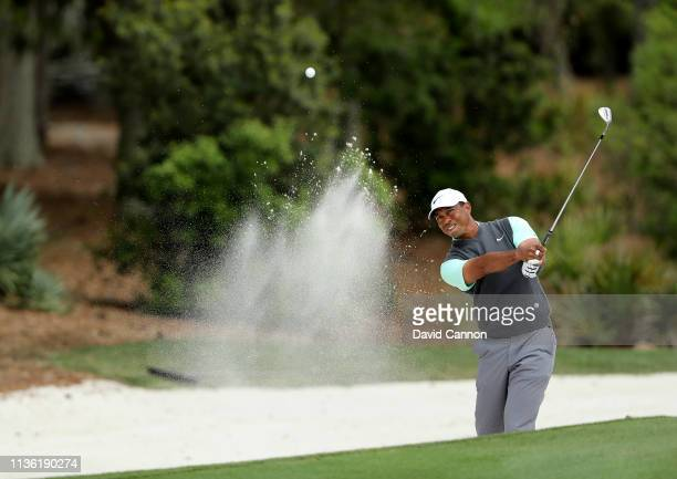 Tiger Woods pf the United States plays his third shot on the par 5, second hole during the third round of the 2019 Players Championship held on the...