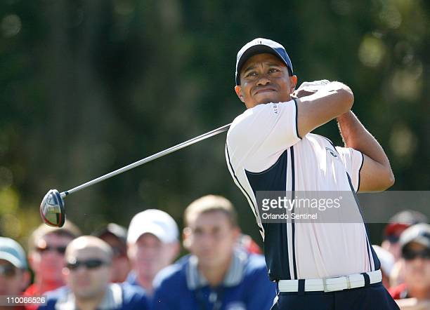 Tiger Woods, playing for Albany, tees off on the third hole during round one of Tavistock Cup at Isleworth Golf and Country Club in Windermere,...