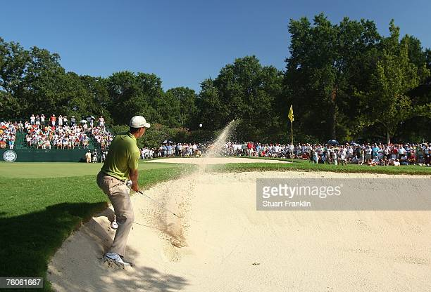 Tiger Woods plays a bunker shot on the 14th hole during the third round of the 89th PGA Championship at the Southern Hills Country Club on August 11...
