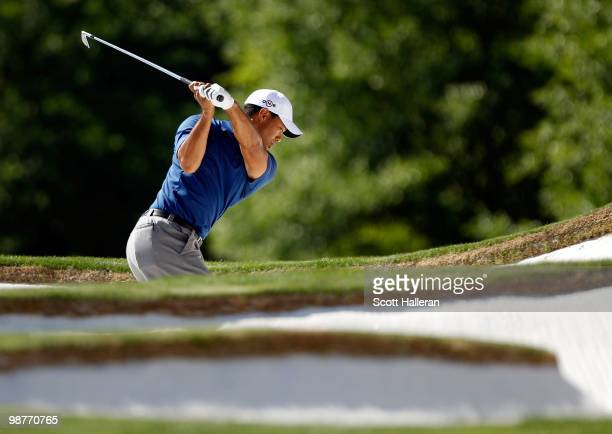 Tiger Woods plays a bunker shot on the 15th hole during the second round of the 2010 Quail Hollow Championship at the Quail Hollow Club on April 30,...