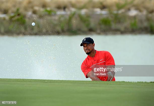 Tiger Woods plays a bunker shot on the fifth hole during the final round of the Hero World Challenge at Albany course on December 4 2016 in Nassau...