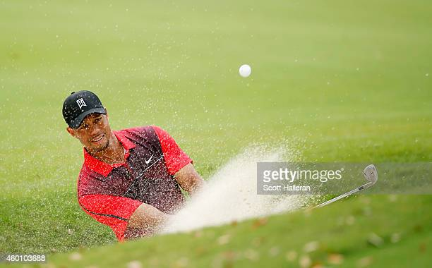 Tiger Woods plays a bunker shot on the fourth hole during the final round of the Hero World Challenge at the Isleworth Golf & Country Club on...
