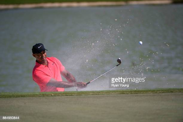 Tiger Woods plays a bunker shot on the ninth hole during the final round of the Hero World Challenge at Albany course on December 3 2017 in Nassau...