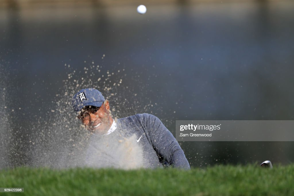 Tiger Woods plays a shot from a bunker on the 13th hole during the first round of the Valspar Championship at Innisbrook Resort Copperhead Course on March 8, 2018 in Palm Harbor, Florida.