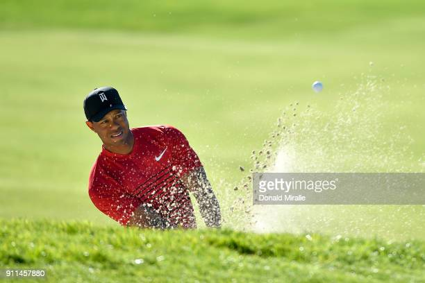 Tiger Woods plays a shot from a bunker on the 15th hole during the final round of the Farmers Insurance Open at Torrey Pines South on January 28 2018...