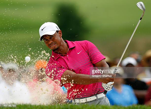 Tiger Woods plays a shot from a sand trap on the ninth hole during the third round of the World Golf ChampionshipsBridgestone Invitational at...