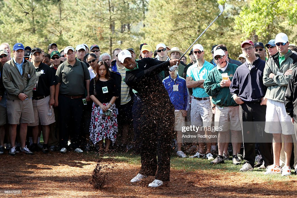 Tiger Woods plays a shot from the pine needles on the first hole during the second round of the 2010 Masters Tournament at Augusta National Golf Club on April 9, 2010 in Augusta, Georgia.