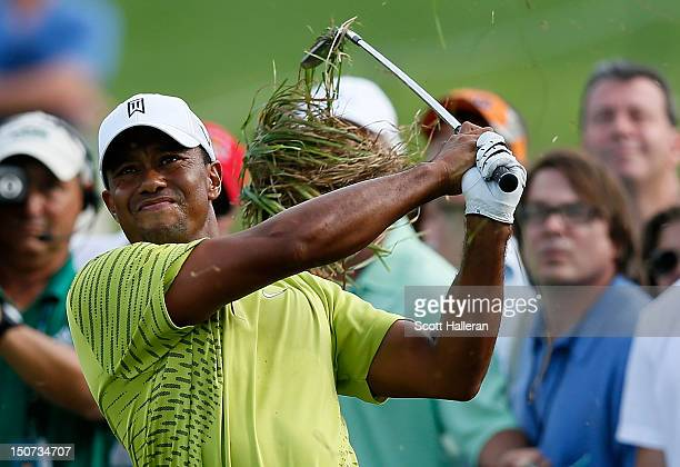 Tiger Woods plays a shot from the rough on the 15th hole during the third round of The Barclays at the Black Course at Bethpage State Park August 25...