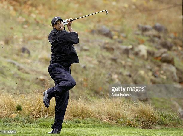 Tiger Woods plays a shot from the rough on the 16th hole during the final round at the Target World Challenge on December 14 2003 at the Sherwood...