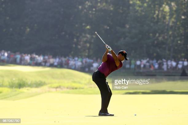 Tiger Woods plays a shot on the 11th fairway during the second round of the Quicken Loans National at TPC Potomac on June 29 2018 in Potomac Maryland