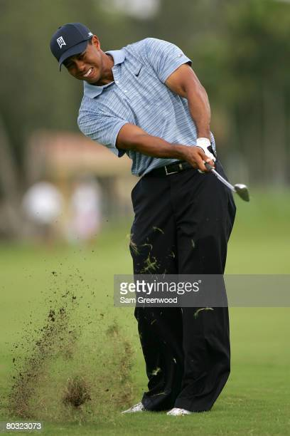 Tiger Woods plays a shot on the 6th hole during the first round of the World Golf Championships CA Championship at the Doral Golf Resort Spa on March...