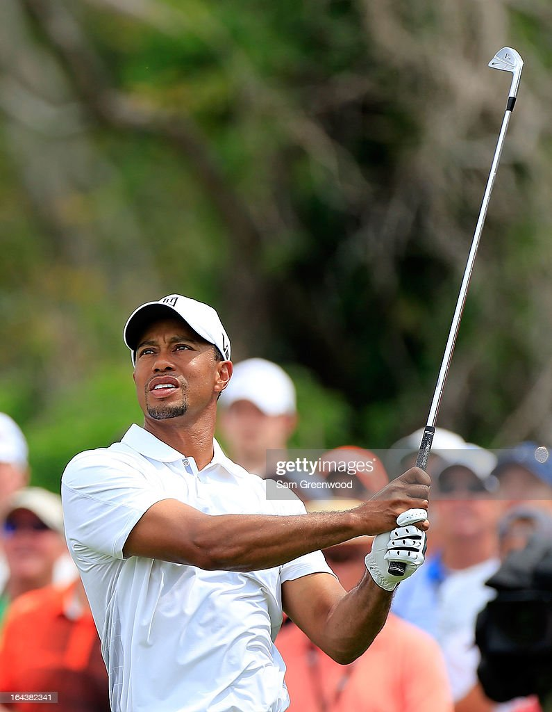 Tiger Woods plays a shot on the 7th hole during the third round of the Arnold Palmer Invitational presented by MasterCard at the Bay Hill Club and Lodge on March 23, 2013 in Orlando, Florida.