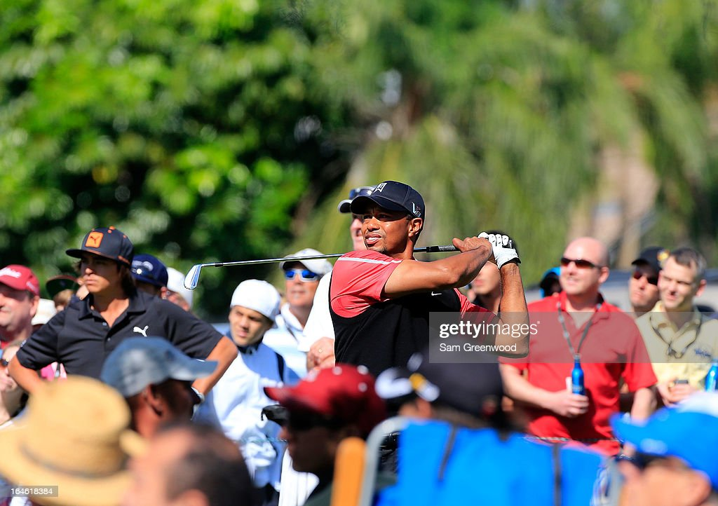 Tiger Woods plays a shot on the 8th hole during the final round of the Arnold Palmer Invitational presented by MasterCard at the Bay Hill Club and Lodge on March 25, 2013 in Orlando, Florida.