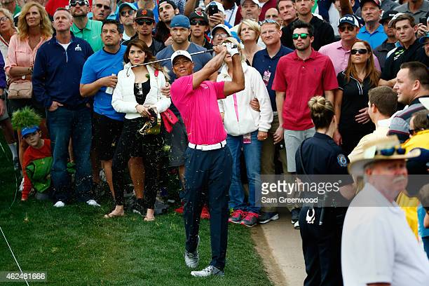 Tiger Woods plays a shot on the 8th hole during the first round of the Waste Management Phoenix Open at TPC Scottsdale on January 29, 2015 in...