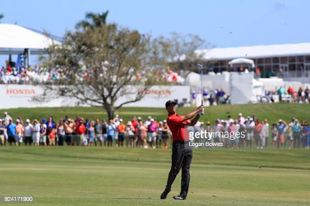 Tiger Woods plays a shot on the first hole during the final round of the Honda Classic at PGA National Resort and Spa on February 25 2018 in Palm...