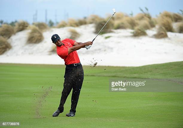Tiger Woods plays a shot on the fourth hole during the final round of the Hero World Challenge at Albany course on December 4 2016 in Nassau Bahamas