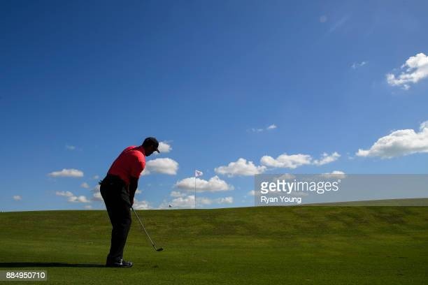 Tiger Woods plays a shot on the third hole during the final round of the Hero World Challenge at Albany course on December 3 2017 in Nassau Bahamas