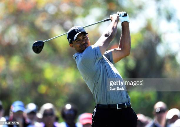Tiger Woods plays a tee shot from the fifth hole during the second round of the World Golf Championships-Cadillac Championship at TPC Blue Monster at...