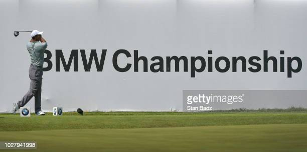 Tiger Woods plays a tee shot on the 18th hole during the first round of the BMW Championship at Aronimink Golf Club on September 6, 2018 in Newtown...