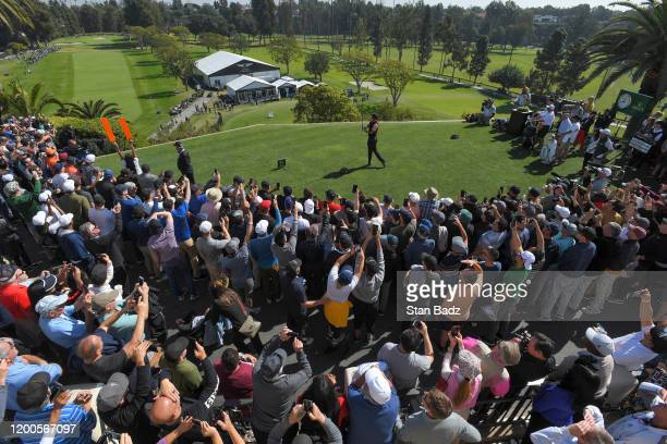 Tiger Woods plays a tee shot on the first hole during the first round of the Genesis Invitational at Riviera Country Club on February 13 2020 in...