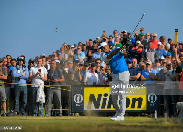 Tiger Woods plays a tee shot on the ninth hole during the first round of the 147th Open Championship at Carnoustie Golf Club on July 19 2018 in Angus...